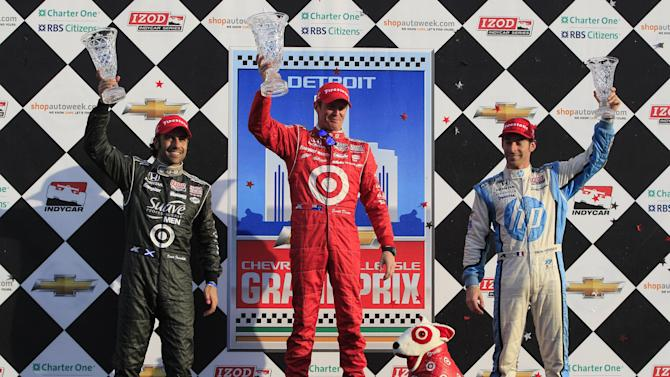 From left, Dario Franchitti, of Scotland, Scott Dixon, of New Zealand, and Simon Pagenaud, of France, stand on the podium after IndyCar's Detroit Grand Prix auto race on Belle Isle in Detroit, Sunday, June 3, 2012. Dixon won the race, while Franchitti came in second and Pagenaud finished third. (AP Photo/Carlos Osorio)