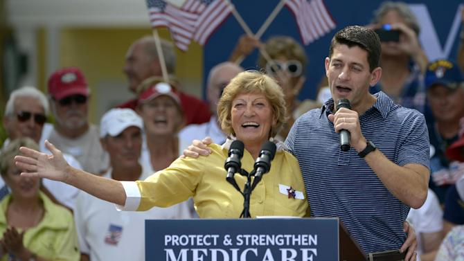 FILE - This Aug. 18, 2012 file photo shows Republican vice-presidential candidate Rep. Paul Ryan, R-Wis., right, introducing his mother, Betty Ryan Douglas, to supporters at a campaign rally in The Villages, Fla. Get in line, Medicare and Social Security. Seniors, like just about everyone else, have money on their minds. Seniors vote at a higher rate than any other age group, so they'll be a deciding factor in the presidential election. Seniors backed the Republican candidate in the last two presidential elections. (AP Photo/Phelan M. Ebenhack, File)