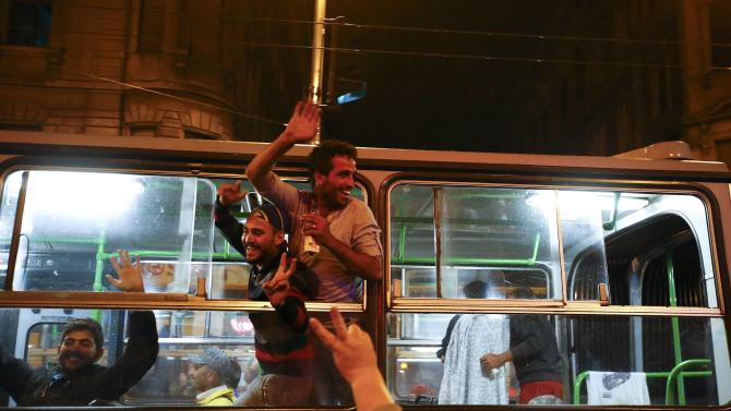 Migrants react in a bus, which is supposed to leave to Austria and Germany, at the Keleti trainstation in Budapest