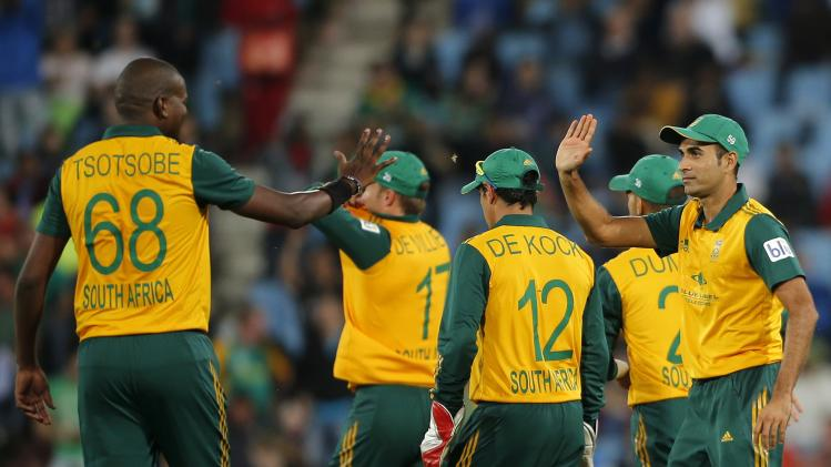 South Africa's cricket players celebrate the dismissal of Australia's Cameron white who was caught out by Imran Tahir during the final of the T20 cricket test match in Centurion