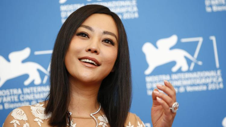 """Chinese actress Hao Lei poses during the photocall for the movie """"Qin'ai de"""" at the 71st Venice Film Festival"""