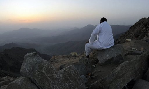A man sits on the side of a hill waiting to see the new moon of Ramadan. Ramadan will begin on Friday in most Arab countries, religious authorities announced, but in Oman and Syria as well as for Iraq's Sunni Muslims and in non-Arab Iran it will start on Saturday