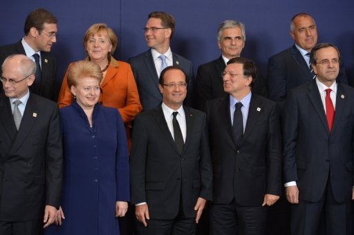 <p>European leaders take their positions for a family photo during an EU summit in Brussels. The European Central Bank will be charged with supervising all 6,000 eurozone banks from 2014, a French government source said on Thursday, as EU leaders thrash out an accord on a banking union.</p>