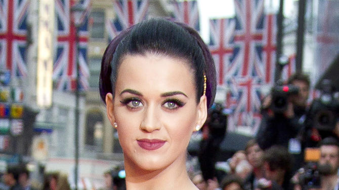 """FILE - This July 3, 2012 file photo shows U.S. singer Katy Perry at the European Premiere of her film """"Part of Me"""" in London. Perry is the new celebrity endorser for the snack brand Popchips. According to a company statement released Wednesday, July 25, 2012 the pop star has become an investor and representative for the chips. (AP Photo/Joel Ryan, File)"""