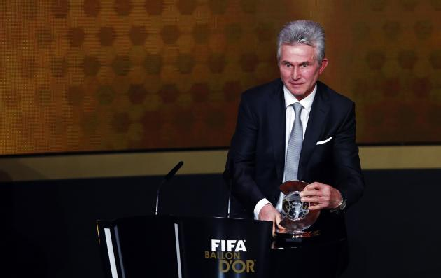 Former Bayern Munich coach Jupp Heynckes holds the trophy after winning the FIFA Coach of the Year award during the FIFA Ballon d'Or 2013 soccer awards ceremony in Zurich