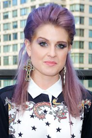 Kelly Osbourne goes bold with brave purple eye shadow at New York Fashion Week