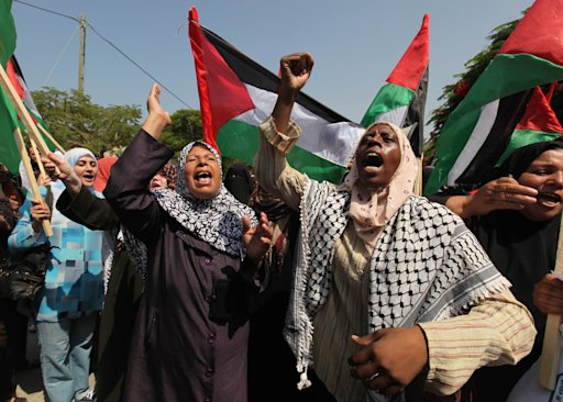Palestinian women take part in a rally in Gaza City