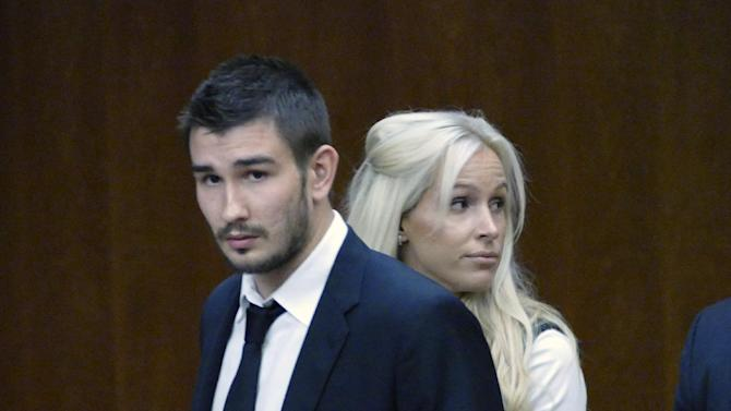 Los Angeles Kings' Slava Voynov enters Superior Court with his wife, Marta Varlamova, Thursday July 2, 2015 in Torrance, Calif. Los Angeles Kings defenseman Slava Voynov pleaded no contest to a misdemeanor Thursday in a domestic violence incident with his wife that escalated after a Halloween party last year.(Brad Graverson/The Daily Breeze via AP)  MAGS OUT; NO SALES; MANDATORY CREDIT