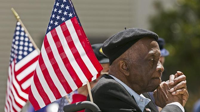 United States Army veteran Sgt. Leon Brookings, celebrates the U.S. Army's 238th Birthday Celebration, Flag Day at the third anniversary of the West Los Angeles Veterans Home, Friday, June 14, 2013, in Los Angeles. (AP Photo/Damian Dovarganes)