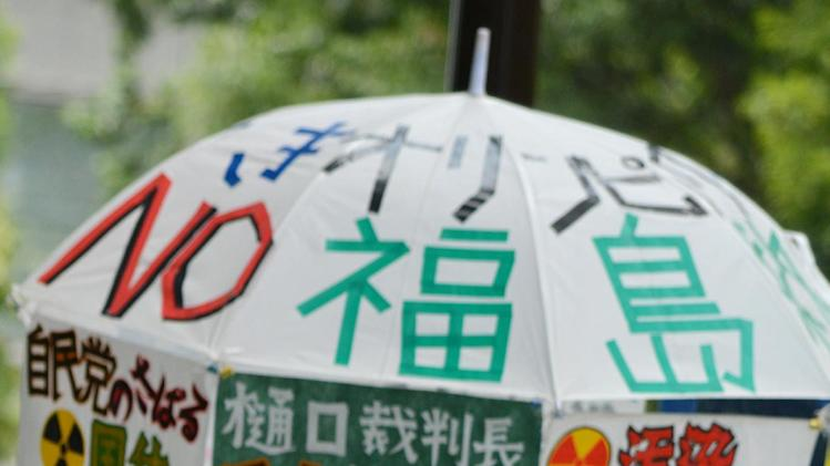 Anti-nuclear demonstrators stage a rally in Tokyo on July 16, 2014 to protest against re-opening the Sendai nuclear power plant operated by Kyushu Electric Power Company