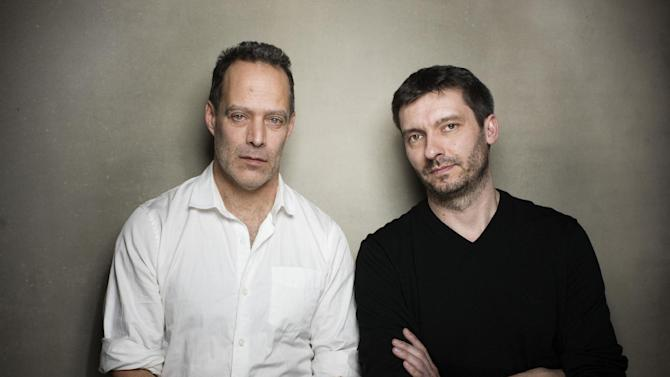 """Director Sebastian Junger, left, and producer James Brabuzon from the film """"Which Way Is Front Line From Here"""" pose for a portrait during the 2013 Sundance Film Festival on Sunday, Jan. 20, 2013 in Park City, Utah. (Photo by Victoria Will/Invision/AP Images)"""