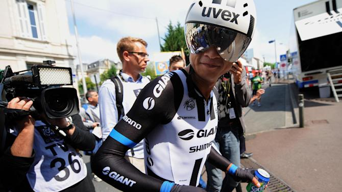 China's Cheng Ji at the finish line of the 20th stage of the Tour de France cycling race on July 26, 2014