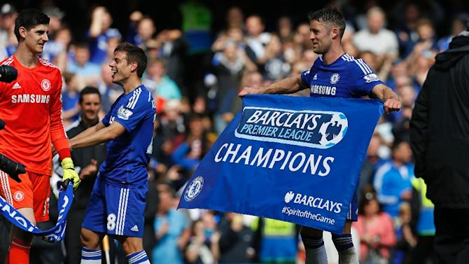 Chelsea's English defender Gary Cahill (R) holds a Champions flag after their English Premier League football match against Crystal Palace at Stamford Bridge in London on May 3, 2015