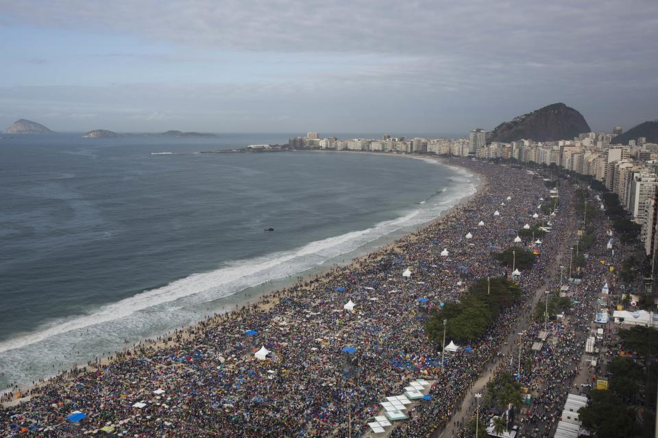 People pack Copacabana beach in Rio de Janeiro, Brazil, Sunday, July 28, 2013. Hundreds of thousands of young people slept under chilly skies in the white sand awaiting Pope Francis' final Mass for World Youth Day. (AP Photo/Felipe Dana)