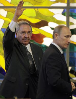 Cuba's President Raul Castro, left, waves as Russia's…