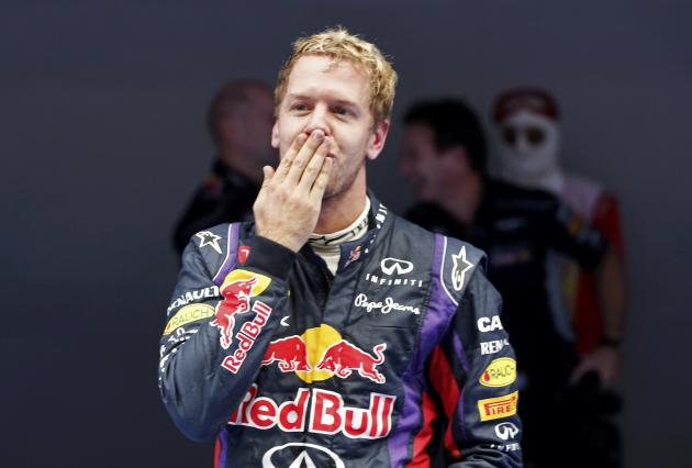 Red Bull Formula One driver Vettel celebrates winning the Indian F1 Grand Prix at the Buddh International Circuit in Greater Noida