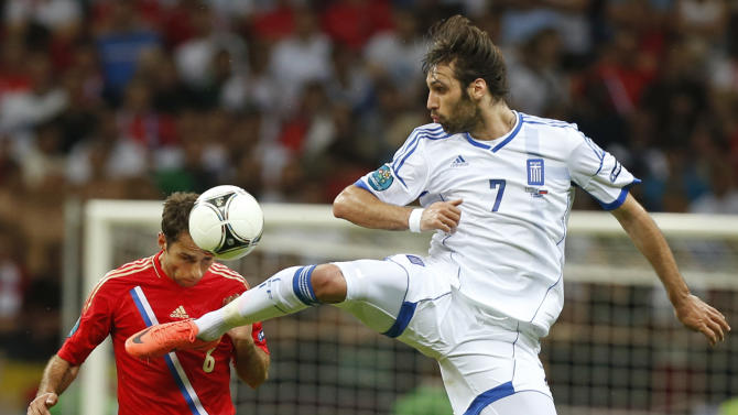 Greece's Giorgos Samaras, right, challenges for the ball with Russia's Roman Shirokov  during the Euro 2012 soccer championship Group A  match between Greece and Russia in Warsaw, Poland, Saturday, June 16, 2012. (AP Photo/Matt Dunham)