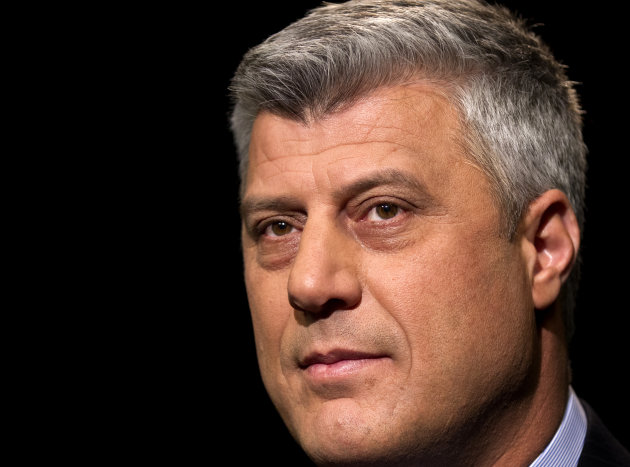 FILE - Kosovo&#39;s Prime Minister Hashim Thaci is seen during an interview with The Associated Press in Washington, in this April 6, 2012 file photo. Thaci said in an interview with the Associated Press Friday Sept. 28, 2012 that Kosovo and Serbia must normalize relations soon to begin integrating with Europe, but he insists that partition of his countrys Serb-dominated northern enclave will never happen. (AP Photo/J. Scott Applewhite, File)