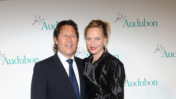 Uma Thurman and Arki Busson attend The National Audubon Society's first gala to jointly award the Audubon Medal and the inaugural Dan W. Lufkin Prize for Environmental Leadership, Thursday, Jan. 17, 2013, in New York.  (Photo by Diane Bondareff/Invision for The National Audubon Society/AP Images)