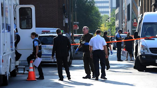 Police work on a crime scene outside the Metropolis in Montreal on Wednesday, Sept.  5, 2012.  A masked gunman wearing a blue bathrobe opened fire during a midnight victory rally for Quebec's new premier, killing one person and wounding another. The new premier, Pauline Marois of the separatist Parti Quebecois, was whisked off the stage by guards while giving her speech and uninjured. It was not clear if the gunman was trying to shoot Marois, whose party favors separation for the French-speaking province from Canada. Police identified the gunman only as a 62-year-old man, and were still questioning him Wednesday morning.  (AP Photo/The Canadian Press, Sean Kilpatrick)
