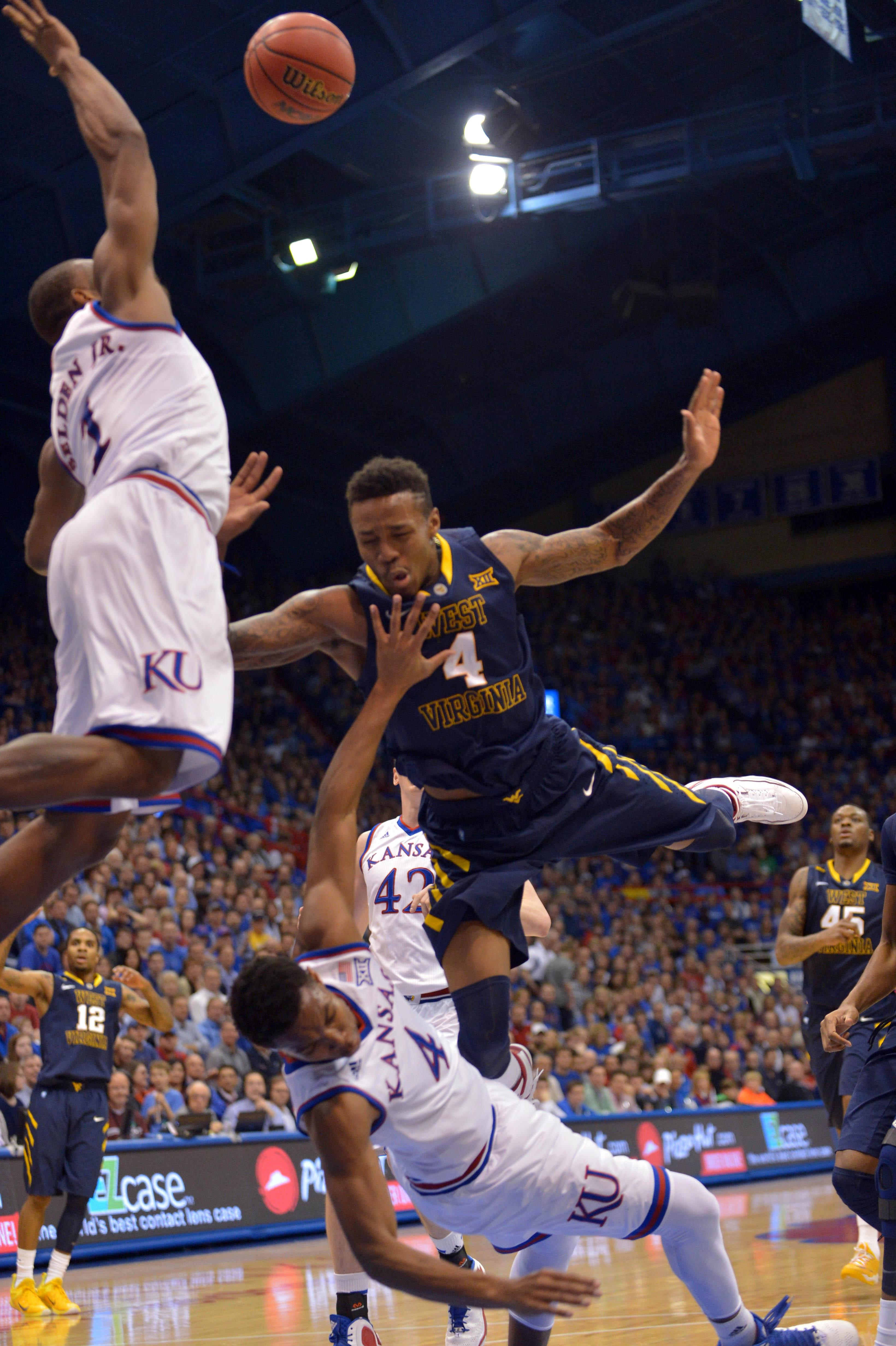 Kansas rallies from 18 down to win 11th Big 12 title outright