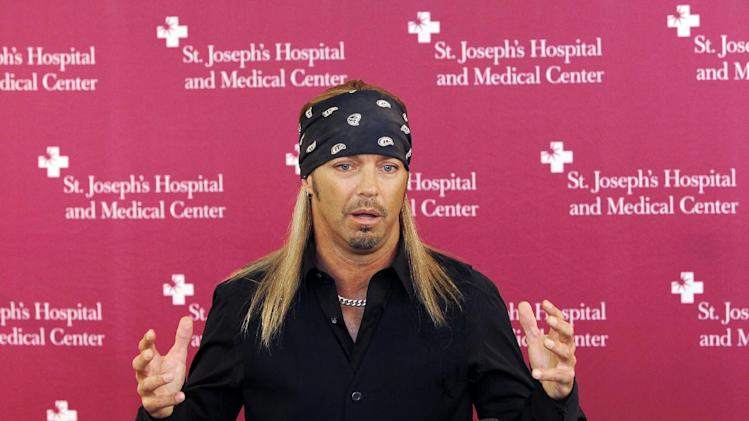 Poison frontman Bret Michaels talks about the designs for a music room he will be funding and decorating at St. Joseph's Hospital and Medical Center Barrow Neurological wing Thursday, Oct. 27, 2011, in Phoenix.  Michaels is a former patient at the Barrow Neurological center, after suffering a type of life-threatening stroke in 2010. (AP Photo/Ross D. Franklin)