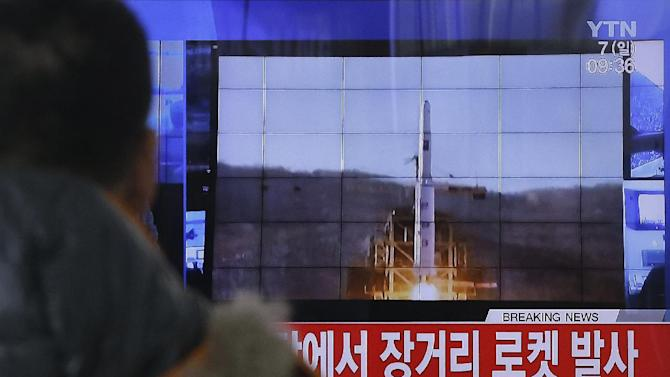 "A South Korean man watches a TV news program with a file footage about North Korea's rocket launch at Seoul Railway Station in Seoul, South Korea, Sunday, Feb. 7, 2016. North Korea on Sunday defied international warnings and launched a long-range rocket that the United Nations and others call a cover for a banned test of technology for a missile that could strike the U.S. mainland. The letters on the screen read: ""North Korea launched a long-range rocket."" (AP Photo/Ahn Young-joon)"