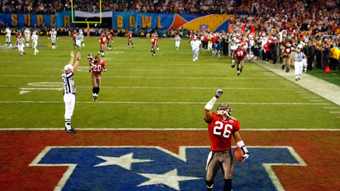 FILE - In this Jan. 26, 2003, file photo, Tampa Bay Buccaneers cornerback Dwight Smith (26) celebrates his 50-yard interception return for a touchdown to cap the Buccaneers' 48-21 win over the Oakland Raiders in NFL football's Super Bowl XXXVII in San Diego. In the 48 year history of the Super Bowl, 2014 is only the second time the No. 1 team in total yards and total passing offense, Denver, has faced the No. 1 defensive team in total yards and passing yards given up: Seattle. The only other time this happened, in 2003, defensive titan Tampa Bay swamped offensive powerhouse Oakland. (AP Photo/Lawrence Jackson, File)