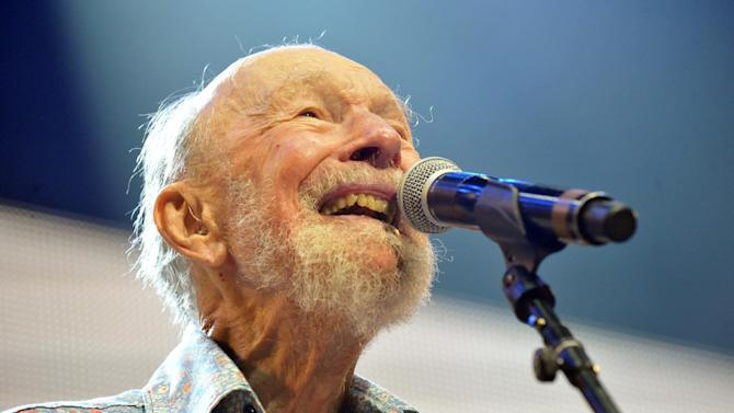 FILE - This Sept. 21, 2013, file photo shows Pete Seeger performing on stage during the Farm Aid 2013 concert at Saratoga Performing Arts Center in Saratoga Springs, N.Y. Seeger's life will be celebrated at the annual Clearwater Festival this summer. Seeger died in January at age 94, after surviving his wife Toshi by about seven months. Clearwater Festival organizers say the two-day show at Croton-on-Hudson starting June 21 will celebrate the couple's legacy. (AP Photo/Hans Pennink, File)