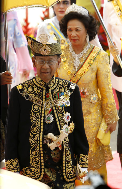 Malaysia's new King Sultan Abdul Halim, front, and Queen Haminah step down from the dais after a welcoming ceremony at the Parliament Square in Kuala Lumpur, Malaysia, Tuesday, Dec. 13, 2011. The 84-y