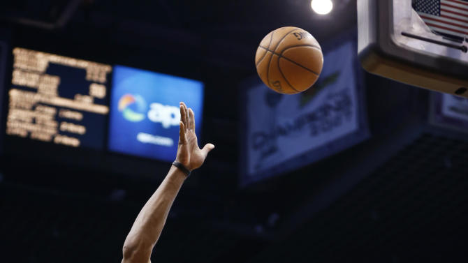 Los Angeles Lakers' Dwight Howard (12) gets off a shot over Phoenix Suns' Hamed Haddadi (98), of Iran, in the first half of an NBA basketball game on Monday, March 18, 2013, in Phoenix. (AP Photo/Ross D. Franklin)