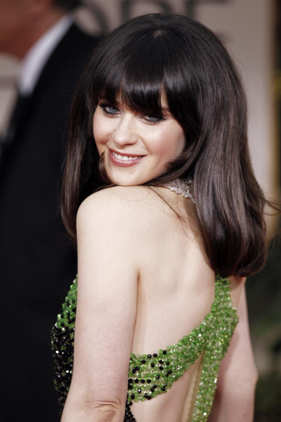 Zooey Deschanel arrives at the 69th Annual Golden Globe Awards Sunday, Jan. 15, 2012, in Beverly Hills, Calif. (AP Photo/Matt Sayles)