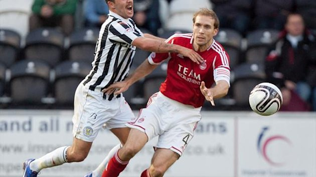 Russell Anderson, right, is bemused by Aberdeen's injury worries