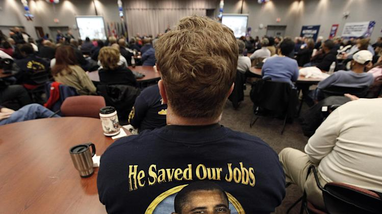 "In this Nov. 6, 2012 photo, United Auto Workers member Harry Van Uden attends a rally on Election Day at the UAW Region 1 technical training center in Warren, Mich. Only a couple of weeks after Barack Obama won the presidency in 2008, the man who would become his Republican challenger in the next election penned a New York Times column with a fateful headline: ""Let Detroit Go Bankrupt."" Those four words would haunt Mitt Romney across the Rust Belt, where auto manufacturing remains an economic pillar _ especially Ohio, which every successful GOP presidential nominee has carried, and his home state of Michigan, where his father was an auto company executive and governor. (AP Photo/Paul Sancya)"