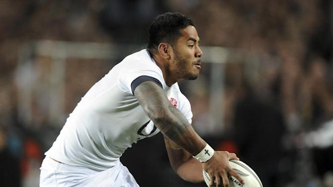 England's Manu Tuilagi dummies the ball against New Zealand during the International Rugby Test at Eden Park in Auckland, New Zealand, Saturday, June 7, 2014. (AP Photo/SNPA, Ross Setford) NEW ZEALAND OUT