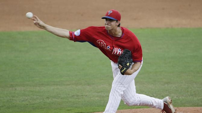 Philadelphia Phillies pitcher Aaron Nola throws in the third inning of a spring training baseball game against the New York Yankees in Clearwater, Fla., Friday, March 27, 2015. (AP Photo/Kathy Willens)