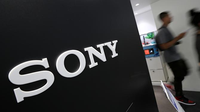 Visitors walk past a logo of Sony at Sony Building in Tokyo Thursday, July 31, 2014. Sony reported a surprise eightfold jump in quarterly profit as sales got a perk from a cheap yen and its bottom line was helped by gains from buildings and its stake in a video-game maker. (AP Photo/Eugene Hoshiko)