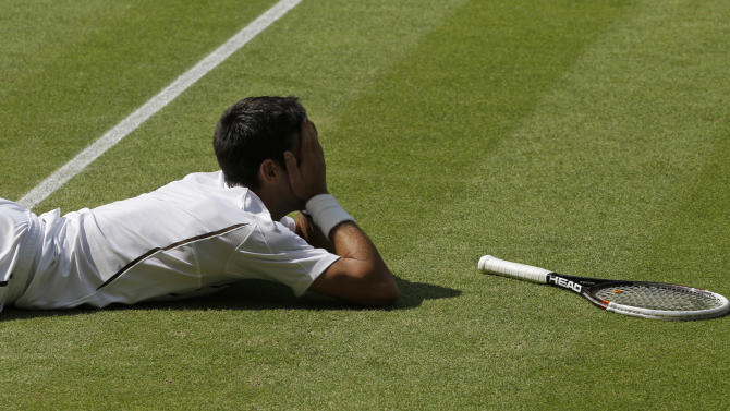 Novak Djokovic of Serbia reacts after missing a return to Juan Martin Del Potro of Argentina during their Men's singles semifinal match at the All England Lawn Tennis Championships in Wimbledon, London, Friday, July 5, 2013. (AP Photo/Anja Niedringhaus)