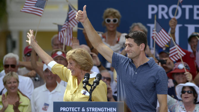 Republican vice-presidential candidate Rep. Paul Ryan, R-Wis., right, and his mother Betty Ryan Douglas wave to supporters at a campaign rally in The Villages, Fla., Saturday, Aug. 18, 2012.(AP Photo/Phelan M. Ebenhack)