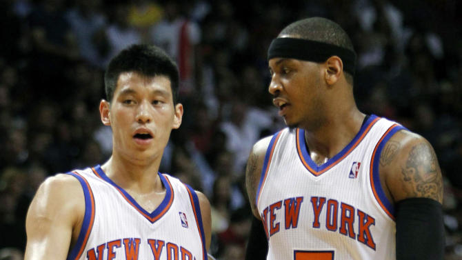 FILE - In this Feb. 12, 2012, file photo, New York Knicks guard Jeremy Lin (17) and teammate Carmelo Anthony (7) talk during the first half of an NBA basketball game against the Miami Heat in Miami. Linsanity could be put to rest in New York when the clock strikes midnight. That's the deadline the Knicks face to match the daunting offer the Houston Rockets have made to Lin, the Harvard point guard who dazzled all of basketball for a brief stretch last season.  (AP Photo/Alan Diaz, File)