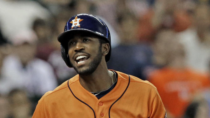 Houston Astros' Dexter Fowler reacts to striking out with the bases loaded against the Seattle Mariners in the third inning of a baseball game Friday, Sept. 19, 2014, in Houston. (AP Photo/Pat Sullivan)