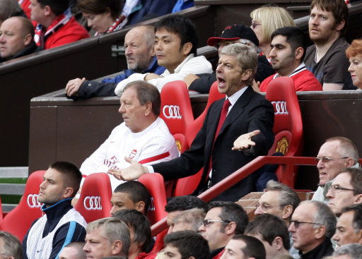Arsenal manager Arsene Wenger reacts during their English Premier League soccer match against Manchester United at Old Trafford, Manchester, England, Sunday Aug. 28, 2011. (AP Photo/Jon Super)