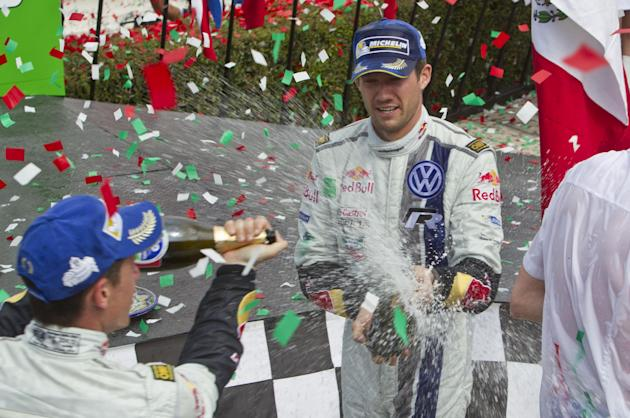 Volkswagen Motorsport team driver Sebastian Ogier, right, and co-driver Julien Ingrassia, both from France, celebrate winning the Mexico Rally in Leon, Mexico, Sunday, March 9, 2014
