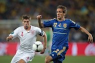 Steven Gerrard (left) put in a man-of-the-match display against Ukraine