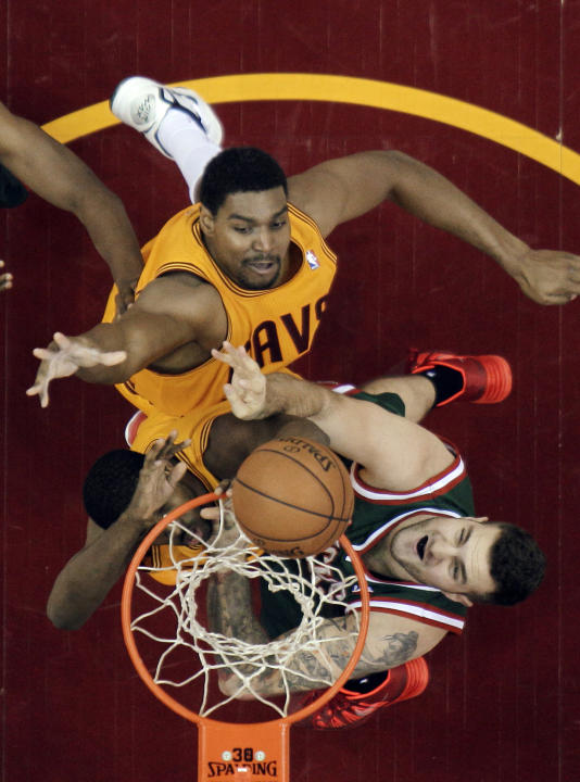 Irving scores 39, Cavs beat Bucks 114-111 in OT