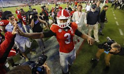 Todd Gurley celebrates with fans after Georgia beat Vanderbilt. (AP)