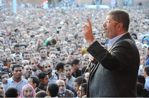 Egypt's President Mohamed Mursi speaks to supporters in front of the presidential palace in Cairo