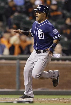 Padres beat Giants 5-3 on safety squeeze in 13th