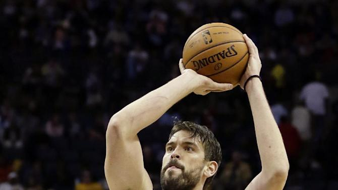 FILE - In this March 29, 2013, file photo, Memphis Grizzlies' Marc Gasol, of Spain, shoots during the second half of an NBA basketball game against the Houston Rockets in Memphis, Tenn. (AP Photo/Danny Johnston, File)