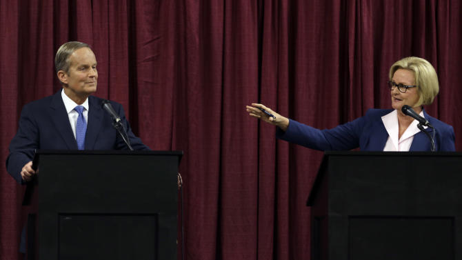 Democratic Sen. Claire McCaskill, right, speaks while looking toward Republican challenger Rep. Todd Akin during the first debate in the Missouri Senate race Friday, Sept. 21, 2012, in Columbia, Mo. (AP Photo/Jeff Roberson)